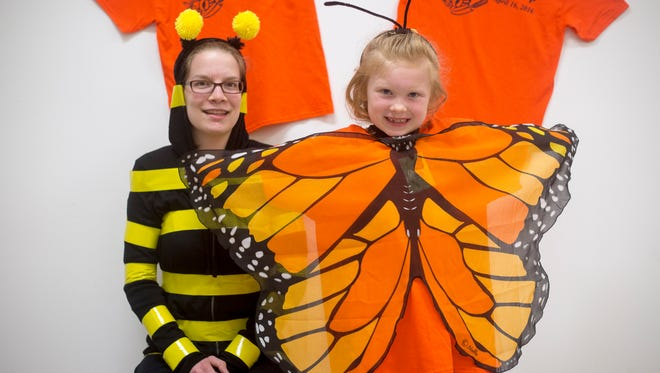 Sophia (right), 6, poses for a photo with Lydia Astrop (left) for a photo at the Mini Master Gardeners Day Camp in April 2016  inside the Mansfield Park Lodge. Around 40 kids ages 5-9 learned about butterflies from their life cycle to what they eat.