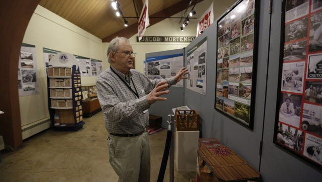 """Curator George Alafouzos of Wausau gives a tour April 15 of the """"Generations of Progress - The Industrial History of Marathon County"""" exhibit at the Marathon County Historical Museum in Wausau."""