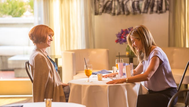 Julia Roberts, left, and Jennifer Aniston in a scene from the motion picture MOTHER'S DAY.