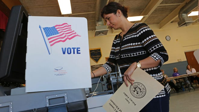 Pamela Kokoros, 28, of New City votes at Street Community Center in New City on primary day, April 19, 2016.