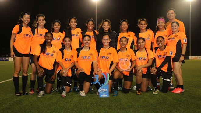 The Personal Finance Center Lady Crushers, the Bud Light Women's Soccer League Spring 2016 Champions after beating the Lady Rovers 5-2 April 24 at the Guam Football Association National Training Center. Front row, from left: Simie Willter, Kimberly Sherman, Anjelica Perez, Colleen Naden, Skyylerblu Johnson, Brittany Meno, and Nieves Cabreza. Standing, from left: Demi Rose Brennan, Katie Mills, Ariya Cruz, Kaeliana Taitano, Maria Abbey Iriarte, Mya Sanchez, Hinako Ito, Sabrina Kenney, Elisa Benavente, PFC President and CEO Mike Camacho, and Carla Haddock.