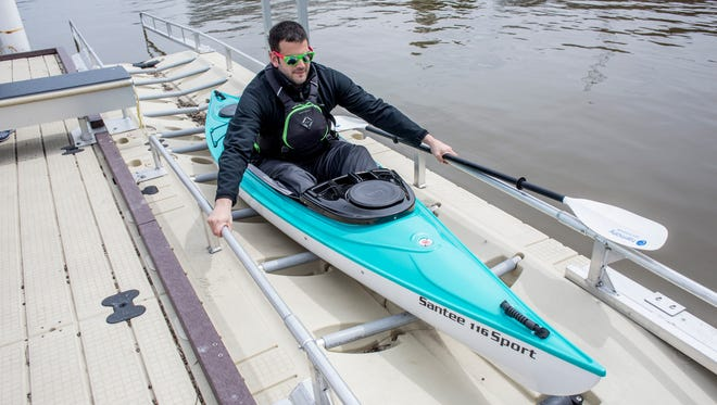 Aaron Kring, of Fort Gratiot, uses a kayak launch while trying out a boat from Missy's Kayak Connection Saturday, April 30, 2016 near Seventh Street on the Black River in Port Huron.