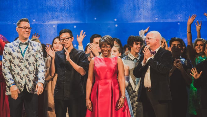 Idyllwild Arts students on stage at The NOVO  with key staff members (front row left to right) programing director Mark Davis,  president Pamela Jordan (in red dress) and Dr. Douglas Ashcraft (clapping).