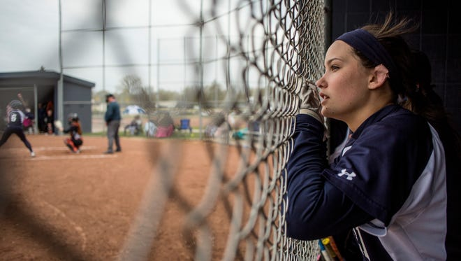 Marysville's Samantha Smith watches the action from the dugout during a softball game Tuesday, May 10, 2016 at Marysville High School.