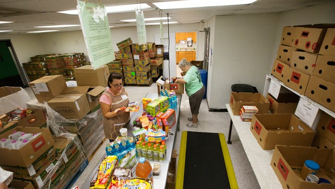 FILE: Vounteers, Kathy McMillan and Palma Balla sort through donated food from retail outlets at the Harry Chapin Food Bank on Thursday, May 12.  The Letter Carriers' #StampOutHunger Food Drive is Saturday, May 14, 2016. This is the biggest one-day drive in the nation. Last year, Lee Co. residents donated 400K pounds of food.