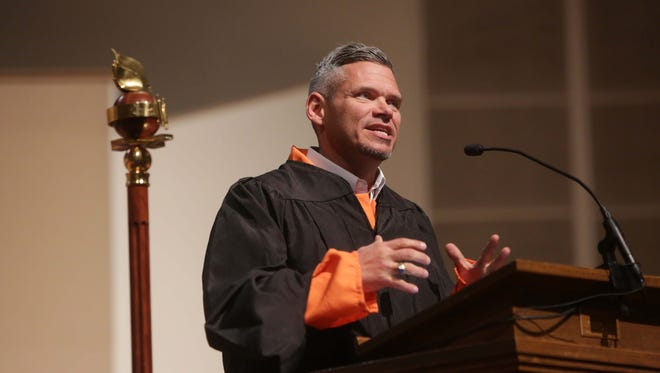 John Alarid, a Master of Arts Candidate with the Assemblies of God Theological Seminary, wore a prison jump suit as he addressed his classmates and faculty during graduation ceremonies Sat., May 7, 2016.