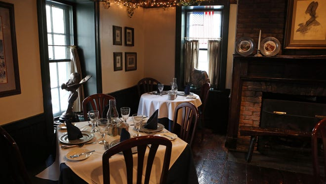 Owner Robert Norden says some ghostly things have happened at the corner table by the window at the 76 House in Tappan, May 13, 2016.