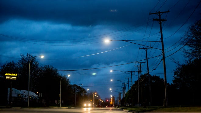LED street lights are seen installed on the north side of Dove Road, right, on Thursday May 12, 2016 in Port Huron.