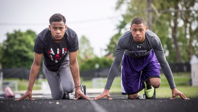 Eliyahu and Eliseus Young line up on starting blocks on Central's track during practice Monday. The fraternal twins will try to bring home a win for Central on Thursday.