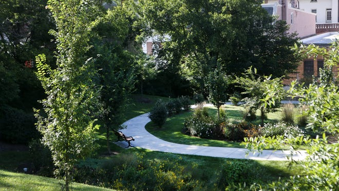 A rain garden and walking path off Queen City Avenue in South Fairmount is among the MSD projects Cincinnati parks oversaw.