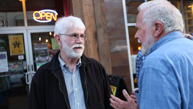 Salem mayoral candidate Chuck Bennett, left, talks with Russ Beaton during the local Democratic party at ShotskiÕs Pizza on Tuesday, May 16, 2016, in Salem, Ore.