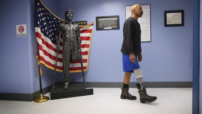 NEW YORK, NY - JANUARY 29:  U.S. Military veteran and amputee Lloyd Epps walks after doctors serviced his prosthetic leg at the Veterans Administration (VA), hospital on January 29, 2014 in Manhattan, New York City. Epps, who lost his leg to an infection in 2010, wears a hightech custom prosthetic from the VA which powers his gait forward.  (Photo by John Moore/Getty Images)