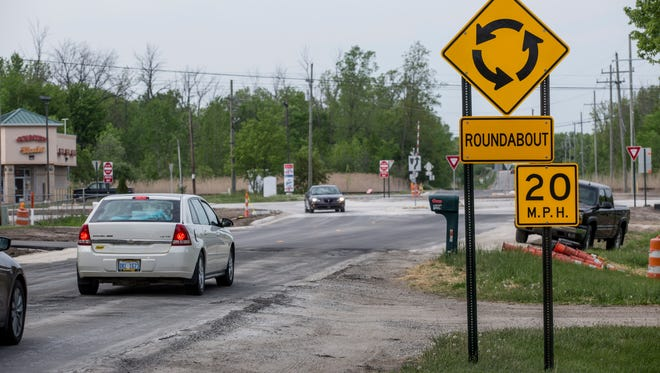 Vehicles approach the new roundabout Friday, May 27, 2016 at the intersection of Griswold and Range Roads at the border of Kimball and Port Huron townships.
