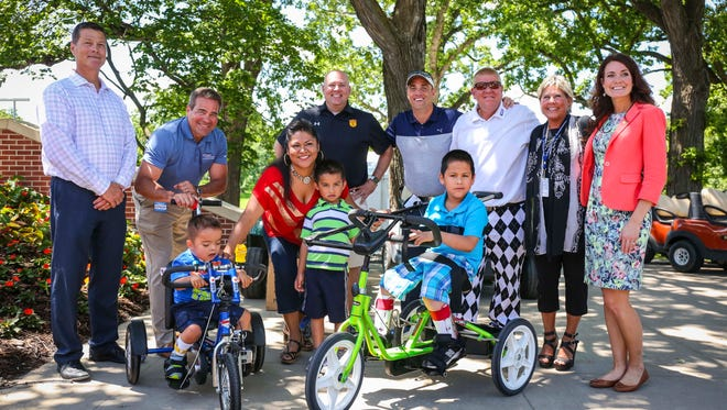 Nery Escobar-Burciaga, 7, right and his brother Jordy, 5, left, with their specialized bicycles donated wtih money from the Principal Charity Classics and Variety- the Children's Charity of Iowa,  Wednesday June 1, 2016, at the Wakonda Club in Des Moines, Iowa.