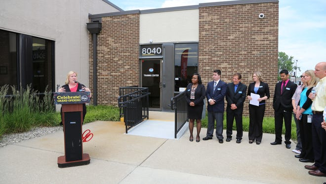 Kroger officials hold a ribbon-cutting event Thursday, June 2, at the company's new training center in Indianapolis.