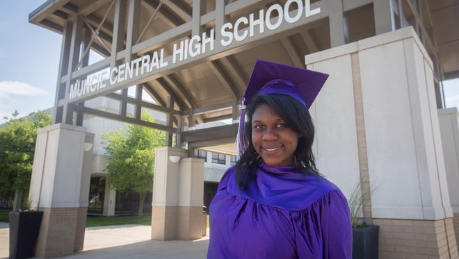 Jenny Gercilus stands ready in cap and gown to graduate from Central High School. Gercilus has overcome physical and emotional abuse at home and will soon be enrolled at Ball State University.