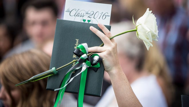 Students and family try to find eachother following the graduation ceremony for Yorktown High School June 5, 2016 at Emens Auditorium.