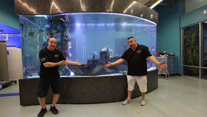 """Wayde King (right) and Brett Raymer of """"Tanked"""" pose with their aquarium at the Imaginarium."""