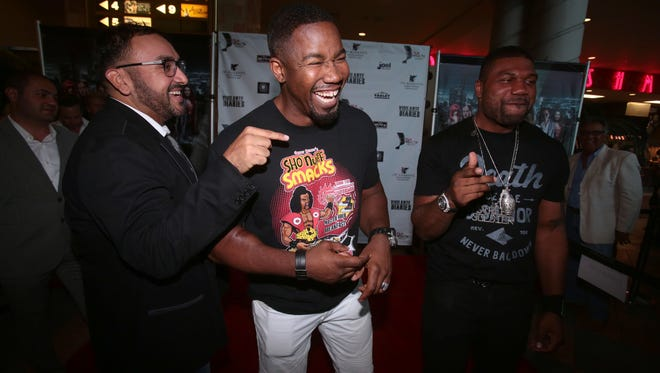 Director Christian Sesma, left,  is the new Chief Operating Officer with iRecover Addiction Treatment Centers in Cathedral City. In this photo he jokes around with actors Michael Jai White, center, and Quinton 'Rampage' Jackson, right, at a red carpet screening of 'Vigilante Diaries' at the Mary Pickford Theater in Cathedral City on Saturday, June 18, 2016.
