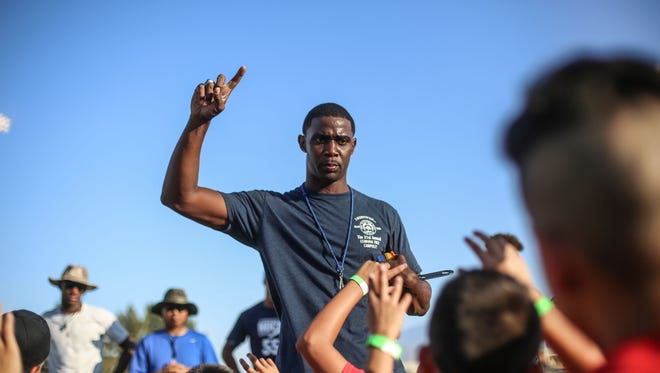 Jeff Webb an ex-NFL player and La Quinta High School CIF Champion asks kids at his football camp held at La Quinta High School if they want to play high school football on Saturday, June 25, 2016.