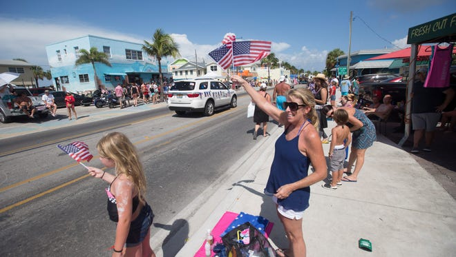 Maureen and Morgan Moravec enjoy the Fourth of July Parade on Fort Myers Beach Monday.