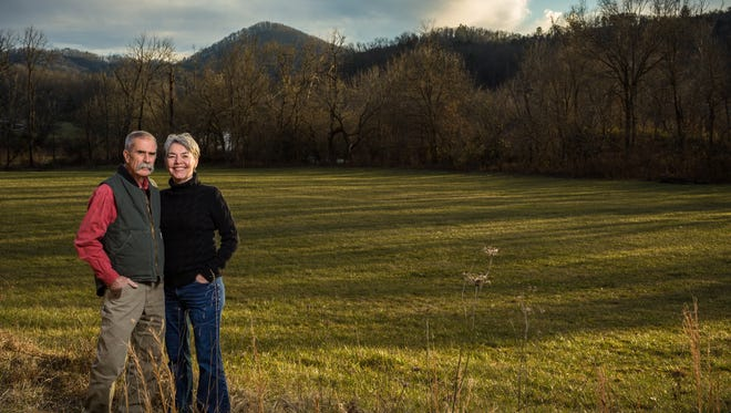 Sharon Taylor, executive director for Mainspring Conservation Trust, and her husband, George Taylor, conserved their land at Roper Knob, seen in the distance, in Franklin.
