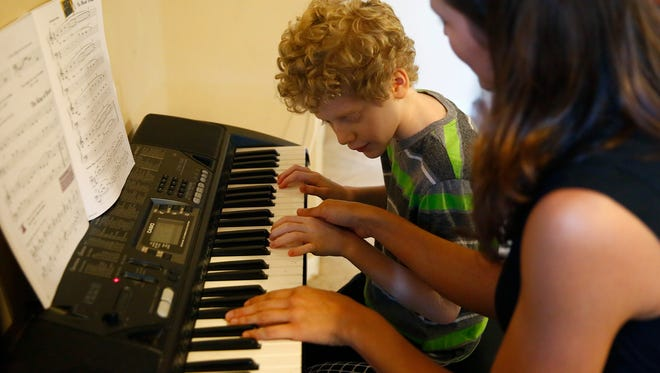 Alejandro Gil De Rubio, 9, practices with piano teacher, Sabrina Gruber at his Lehigh Acres home. Almost completely blind – Alejandro – who suffers from albinism, became a Hope Wishes beneficiary through Hope Hospice. It's a program where Hope helps with wishes of family members who face financial hardship. Someone in his family asked Alejandro get to work with Hope's music therapist for piano lessons.