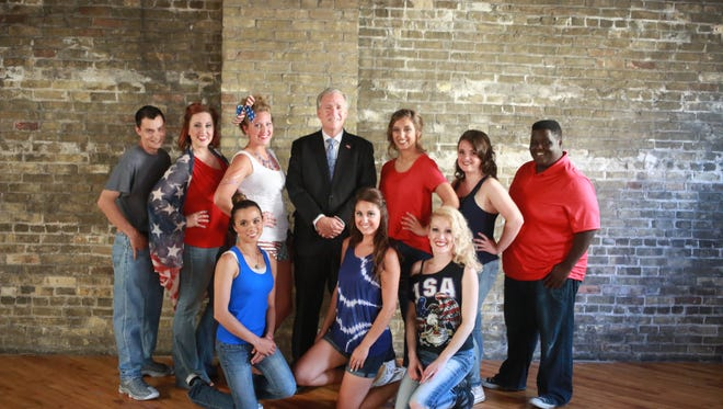 The top nine competitors in Lakeshore's Rising Stars pose with President George W. Bush impersonator John Morgan in week three.