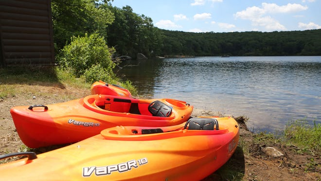 Kayaks off Breakneck Pond at the Harriman Outdoor Center in Harriman State Park July 6, 2016 in Haverstraw. The Appalachian Mountain Club's newest center offers cabins, lodges, spaces for tents, swimming, kayaking and canoeing at Breakneck Pond and a dining facility.