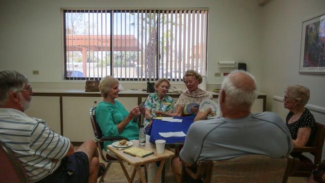 Friends play cards at the Joslyn Senior Center in Palm Desert.   
