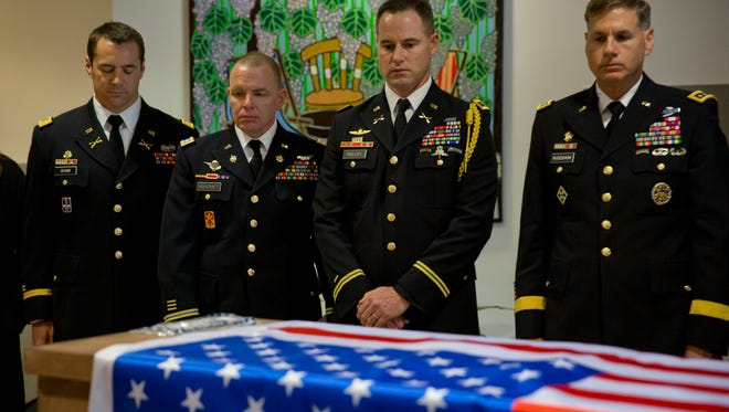 In this March 11, 2016 photo, U.S. military officers stand around the coffin of American Taylor Force, a 28-year-old MBA student at Vanderbilt University and a West Point graduate, who was killed in a stabbing attack, during a private ceremony, at Ben Gurion airport, near Tel Aviv, Israel.