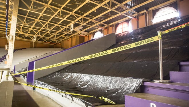 Black tarps block the entire east side seating area of the Fieldhouse after structural issues were discovered with the eastern side support columns which has caused seats to sag and flooring to lift.