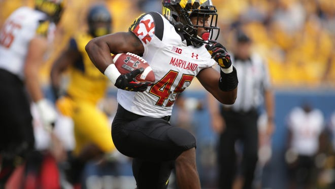 Maryland running back Brandon Ross (45) during the first half/ second half of a game, Saturday, Sept. 26, 2015, in Morgantown, W.Va. (AP Photo/Raymond Thompson)