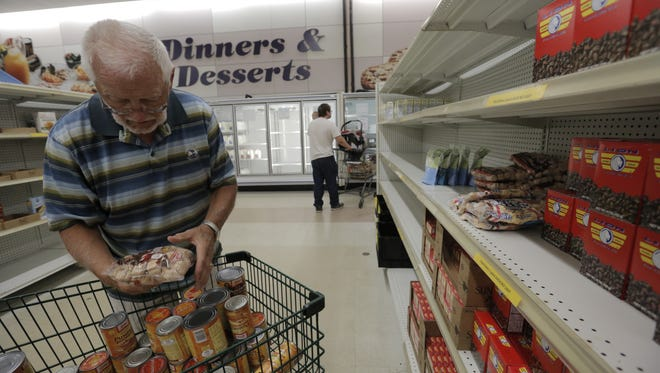Jim Retzloff volunteers at the Oshkosh Area Community Pantry puts items on the shelves Wednesday, July 13, 2016.  The OACP has over 2000 families it serves on a monthly basis.  They rely on community donations to support their pantry. Joe Sienkiewicz / USA TODAY NETWORK-Wisconsin