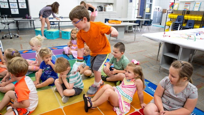 Oliver Earles-Heller, 4, counts his classmates Friday, July 22, 2016, during the Preschool Creations: Creative Little Hands class at Westridge Elementary School in West Des Moines.
