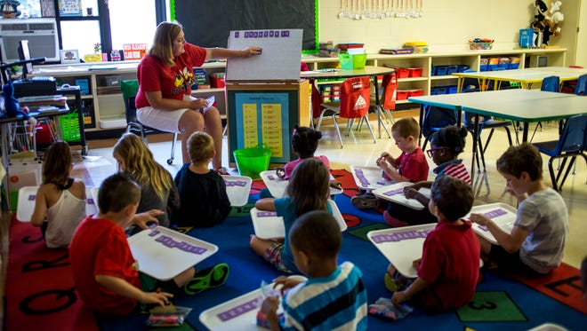 Kindergarten teacher Laura Gleason leads a math lesson with her class Wednesday, July 20, 2016 at Cleveland Elementary School. Kindergarten classrooms at the school would be renovated under the Port Huron Schools bond.
