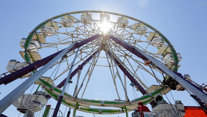 People ride on a Ferris wheel Friday during the Lincoln County Fair in Merrill.