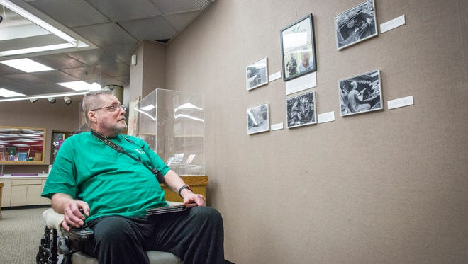 Kevin Durman looks over some of his photos on display at the Heritage Collection Gallery at Minnetrista. The photos focus on Durman's time in the army when we was stationed in West Germany along the soviet border near Schweinfurt with the 7th Calvary division from 1972-1975.