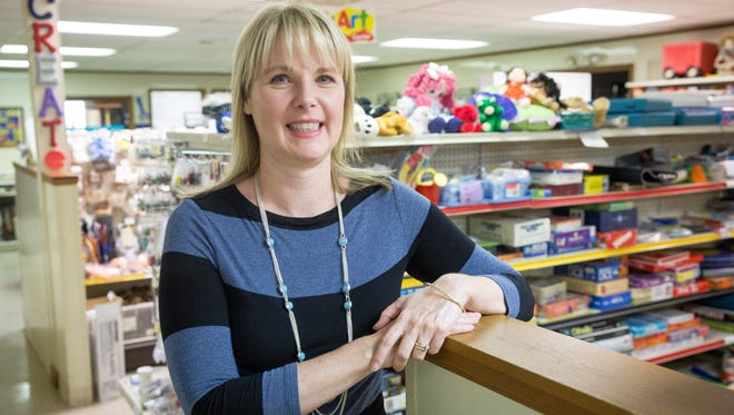 """Stacey Wheeler, the new executive director of the Back to School Teachers store, stands among the dozens of shelves of school supplies that the store offers. The store offers supplies for teachers at no cost, but isn't filling the need for what Wheeler calls """"core"""" supplies, like pencils, paper and glue sticks."""