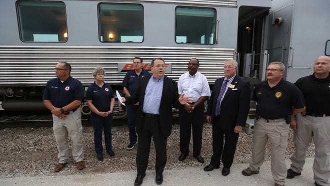 The BNSF railroad invited area first responders and their families aboard the First Responders Express for an evening train ride. Andy Williams, BNSF Regional Public Affairs Director, center, presented donations to two law enforcement organizations.
