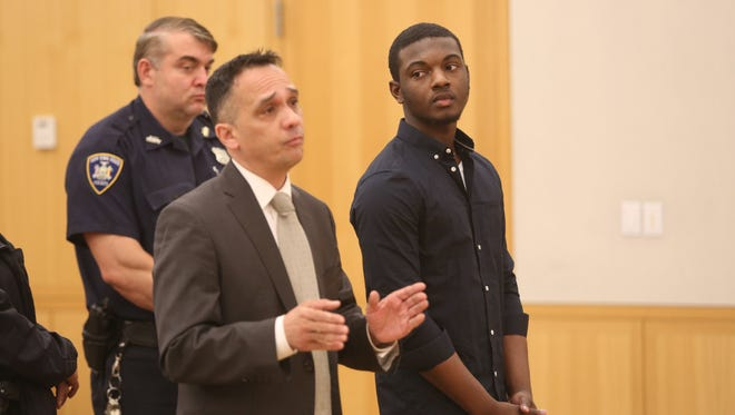 Nashaun Hunter, right, appears in Westchester County Court with his attorney Sherman Jackson, July 27, 2016, to plead guilty in connection with the death of Mike Nolan, from Yonkers.