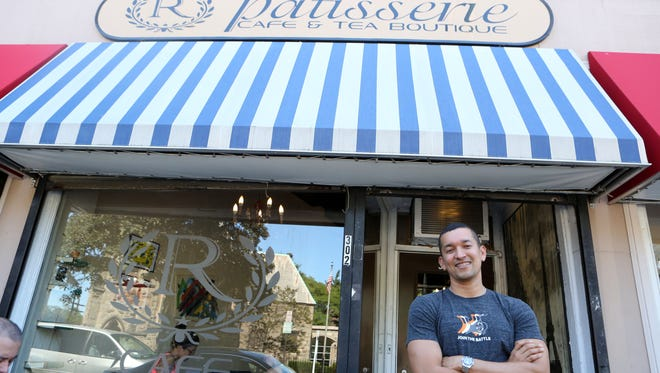 John Reverol stands in front of his coffee shop, where New Rochellians come for open mic nights, art showcases, meet-ups and, of course, coffee.