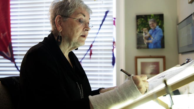 Gerry Nichols, 72, demonstrates different styles of calligraphy in her Naples home on Tuesday, Aug. 2, 2016. Nichols started doing calligraphy in 1968 when she took her first class.