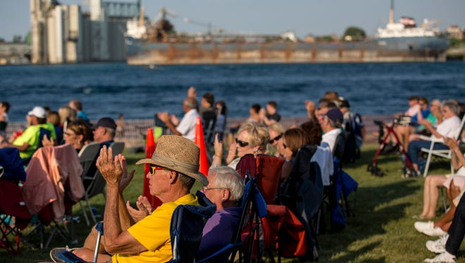 People clap as Port Huron band Double Play performs during Rockin' the Rivers Thursday, August 4, 2016 at Kiefer Park in Port Huron.