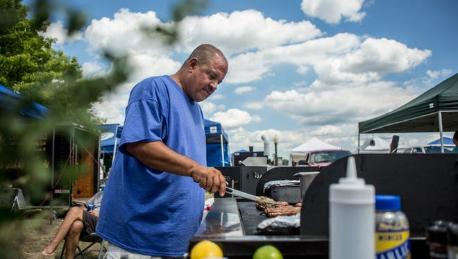 Mike Pappas, of St. Clair, works the grill during the Maritime Days Ribs on the River BBQ competition Saturday, August 6, 2016 at Nautical Mile Park in Marine City.