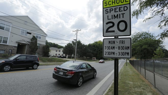 Traffic on South Fourth Street passes a school zone sign Tuesday near Thomas Miller Elementary School.