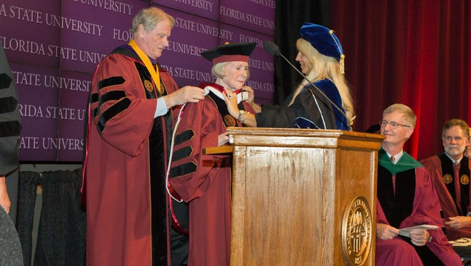 FSU President John Thrasher  helps Tallahassee philanthropist Grace H. Dansby with her hood as she receives honoraryr doctorate of laws degree on Tuesday, Aug. 9, 2016.
