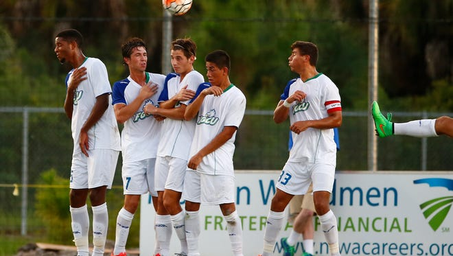 Florida Gulf Coast University players create a wall on a penalty kick during the first half Wednesday, Sept. 2, 2015 at FGCU's Soccer Complex in Estero, Fla. The 19th ranked FGCU Eagles faced UCF in their second contest of the season.