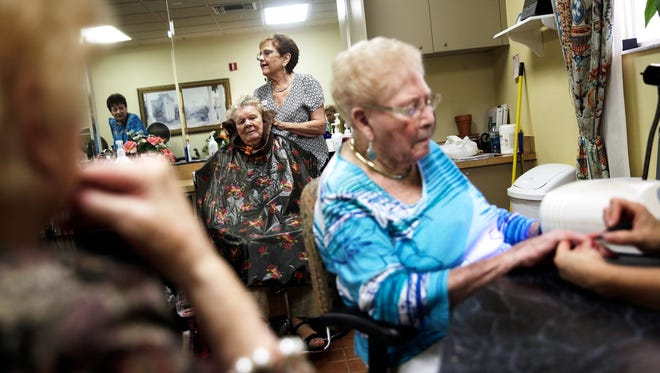 Arlene Watrous, 95, center, has her hair done by hair stylist Barbara Visser at the hair salon at The Carlisle Naples assisted living facility on Thursday, August 4, 2016. Visser has been doing hair for the residents at the Carlisle for 15 years.
