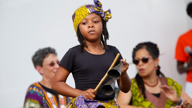 Sandrya Francois, 8, of Spring Valley performs with Chiku Awali, an African arts group, at the 13th annual Spring Valley Day.